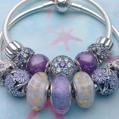 Pandora Forget-me-not Charm and spacers have been added to the flower bed. The…
