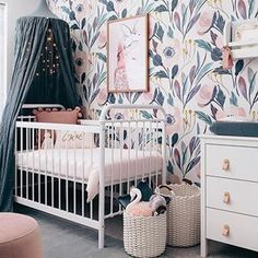 Only the cutest nursery EVER!!! We're swooning over this beautiful room designed by @oh.eight.oh.nine using our Moody Floral removable wallpaper! Tag a friend who needs to see this