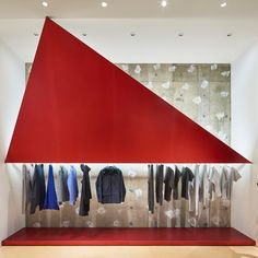 Tokujin Yoshioka installs giant red<br /> triangles for Tokyo Issey Miyake store