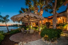 Tarpon Springs Resort-Inspired Home - tropical - landscape - tampa - Housetrends Magazine