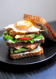 Salmon and avocado club sandwich made with Greek Yogurt. Yes, please!