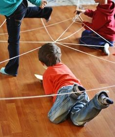 Building Yarn Spiderwebs - Great fine motor AND large motor activity for kids! - Hilary's Home Daycare Vestibular Activities, Physical Activities For Kids, Movement Activities, Motor Activities, Preschool Activities, Preschool Bug Theme, Preschool Education, Preschool Curriculum, Web Activity