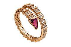 Bulgari's snake-inspired Serpenti line- pink-gold bracelet, pavé-set diamonds and a rubellite head.