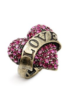 "~Betsey Johnson 'Lady Luck' Heart Stretch Ring~  Vintaged ring boasts a sparkling pavé heart emblazoned with a sentimental banner.Adjustable stretch band.  Approx. setting dimensions: 1 1/4""W x 1 1/4""L.  Base metal/glass/oxidized brass plating.  By Betsey Johnson; imported."