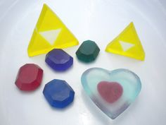 Legend of Zelda heart piece, rupees and triforce soap. Via Geekologie. (Available on Etsy)