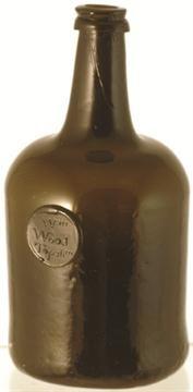TOPSHAM SEALED WINE BOTTLE. 9.25ins tall, c.1770-80 dark olive green glass, applied string rim, s
