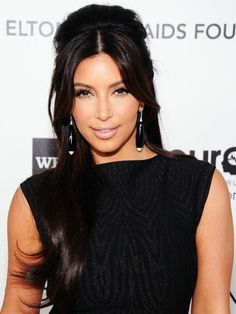 Long & Luscious ~ If you don't want to curl your hair, take your cues from Kim Kardashian and try a center part to give your 'do a modern edge.