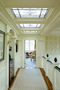 Gorgeous millwork & stainedglass in the upstairs hallway ~ Catalano Architects