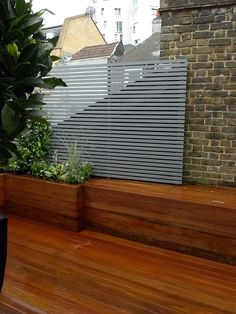 Brick garden wall trellis fake formal low maintenace Wimbledon Putney Wandsworth