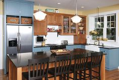 Lake and Home Magazine Hoaglund Feature Home Kitchen: A tasteful splash of color on the lower cabinets completes this country style kitchen.