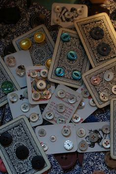 buttons gathered together on to old playing cards
