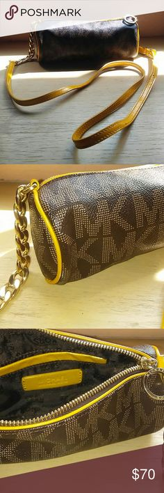 Michael Kora cross body bag Small cylinder bag with metal chain accent, contrast yellow strap and large MK logo. Like new! Michael Kors Bags Crossbody Bags
