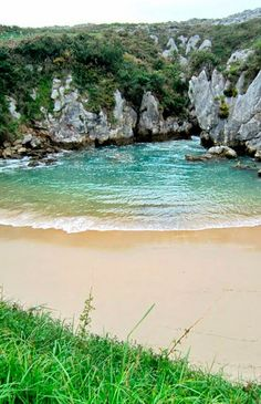 This famous beach (playa de Gulpiyuri) is one of many in picturesque Asturias, Spain.