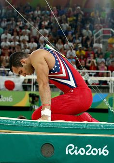 Danell Leyva of the United States reacts after falling from the horizontal bar during the men's team final on Day 3 of the Rio 2016 Olympic…