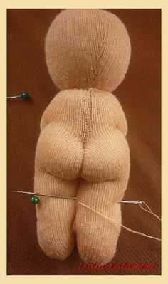 Interesting doll - great pics for needle sculpting techniques