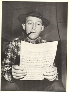 Bing Crosby reading the sheet music