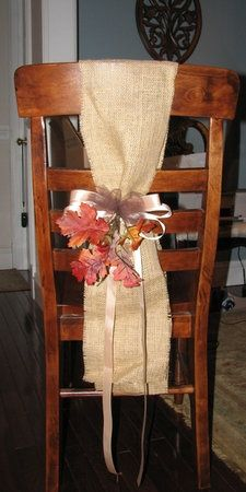 Burlap chair covers lose the flowers and then tie with ribbon that matches wedding colors