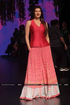 Actress Sangeeta Bijlani's look in a printed skirt and bright red top was a lovely change on the runway.