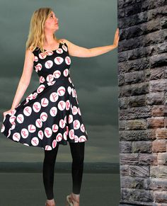 Runic print fit flare dress elder futhark  This flattering dress is designed to hug to the natural waist before flaring out across the hips. The shape is great for taking you through the seasons, accessorised with sunglasses and a wide belt for summer days, or worn with boots and leggings and a cardigan to take you through autumn and into winter. The material has the sheen associated with sublimation printing and a soft feel but is opaque and strong enough to cling to the body without losing…