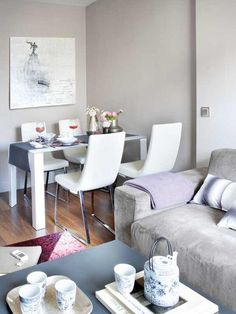 Shades of Pink and Gray Makes 45 Square Meter Apartment More Alive: Small dining room integrated with warm living room