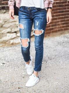 ripped jeans and sneakers