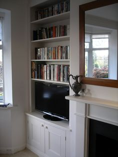 purpose built period style alcove cupboard and bookcase