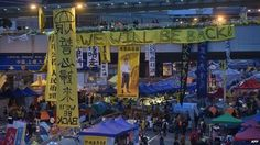 This photo shows an early morning overview of the pro-democracy protest camp in the Admiralty district of Hong Kong on 11 December 2014