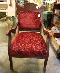 "ANTIQUE BARN AT WATER STREET MARKET NEW PALTZ, 845-255-1403  ""This chair is a 1900 or 1910 beautiful mahogany chair with some inlay, which I really like. It has mother of pearl and gorgeous original fabric. I love that the chair has such a funky shape."""