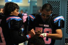 Twelfth grader Tony Viera, 17, writes his aunt's name and birthday on his wrist Oct. 11 ahead of a pink game at Vista Ridge High School in Falcon School District 49. She died of breast, brain, lung and bone cancer. The school's football players and cheerleaders raised $5,000 for the University of Colorado Cancer Center before the pink game, when the Wolves defeated, 63-0, the Kadets from Air Academy High School in Academy School District 20.