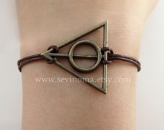 Deathly Hallows bracelet, antique brass deathly hallows charm brown wax rope bracelet, Harry potter. $4.99, via Etsy.