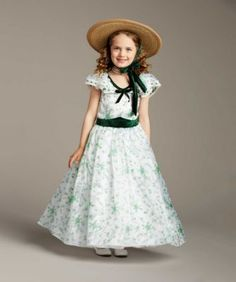 """gone with the wind barbecue party girls costume - ours exclusively - Like many southern gals in """"Gone With the Wind,"""" Scarlett O'Hara wants to stand out at the barbecue party. This spectacular frock will do the trick. With a delicate green floral-print organza overlay, fluttery sleeves and green velour trim, it's ever so charming. The skirt has an inner hoop for that southern-belle fullness and sway. Always impeccable (and unforgettable), you finish with a wide-brimmed hat and ladylike…"""