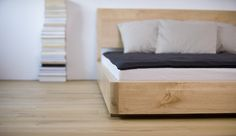 BONDI low bed frame made of birch solid wood.