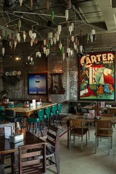 Eclectic, retro, masculine, like the glass bottle light fixtures on the ceiling and huge posters