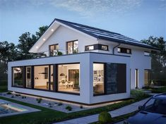 Modern design house with pitched roof – House Concept-M 210 Bien Zenker – Detached house build with bay window Installation floor-to-ceiling windows Balcony – HausbauDirekt. Bungalow Extensions, House Extensions, Living Haus, House Extension Design, Bungalow Renovation, Modern Bungalow, House Roof, Model Homes, Modern House Design