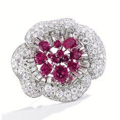 FROM THE ESTATE OF EUNICE JOYCE GARDINER Platinum, Ruby and Diamond Flower Brooch, Cartier, London, Circa 1950