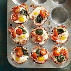 Breakfast Ham and Egg Cups - Just five ingredients make up our too-cute hearty breakfast cups. Simply line each muffin cup with a thin slice of ham, then fill with tasty ingredients such as eggs, tomatoes, and basil pesto.