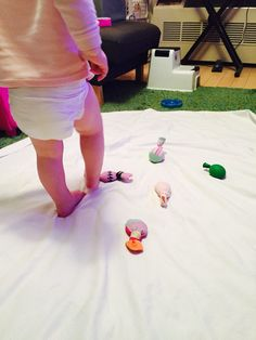 Walking on sensory bags, 20 activities for 12-18 months old, 20 play ideas for toddlers, activities for one year old, montessori activities for a toddler, development promoting activities for toddlers, activities for 13 month old, activities for 14 month old, activities for 15 month old, activities for 16 month old, activities for 17 month old, activities for 18 month old, activities for a toddler, activities for one year olds, activities for two year olds