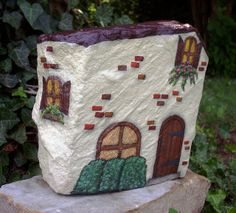 Painted rock fairy house (each color is outlined in fine marker, that's why it looks so detailed)
