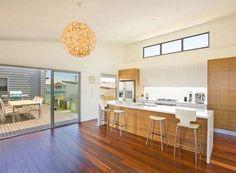 white or ivory kitchen for beach house | glossy white coastal