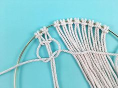 Learn how to make a DIY macrame wall hanging in a brass ring, in this free macrame tutorial pattern from Brooklyn Craft Company. Homemade Dream Catchers, Dreamcatchers, Dream Catcher Tutorial, Half Hitch Knot, Macrame Rings, Macrame Wall Hanging Diy, Granny Square Crochet Pattern, Macrame Design, Macrame Tutorial