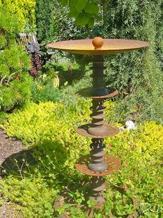 This bird bath made of  rusted old machinery parts was found at Dragonfly Farm