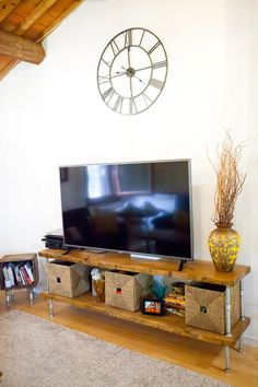 ...and the entertainment center, which is her most prized DIY. The clock is from Maisons du Monde.