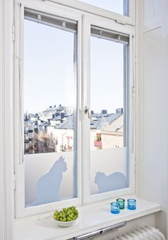 Cats in Window. Adhesive-free and phthalate-free window film by Johanna Lindgren Oern. © Siluett Frost