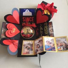 """Buy Explosion Box With Personalized Photo Shaker, Pull Tab In Black , Red & Gold in Singapore,Singapore. ----------- Info ------------- Size: 4x4""""  Explosion box card with 2 layers,  - 2 tags with 2 pocket holders for you to pen yr greetings  - 4 personalized photo Chat to Buy"""