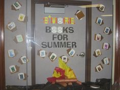 """S'More Books for Summer"" library book bulletin board display"