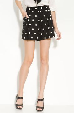 She wears short shorts. Polka dot pleated shorts from Marc Jacobs - Nordstrom $228