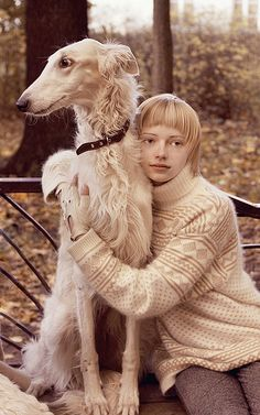 Russian girl with her trusted Borzoi
