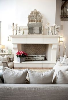 living room faux fireplace. like the painted white branches