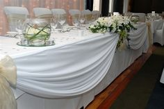 Gorgeous draping on the head table.