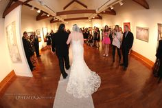 The bride walks down the aisle in a Noyes Museum gallery with an exceptional ceiling and art as a backdrop! #wedding #museum #ceremony #artistic #gallery